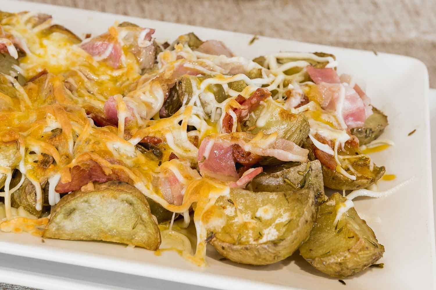 Potatoes with cheese, bacon and pepperoni
