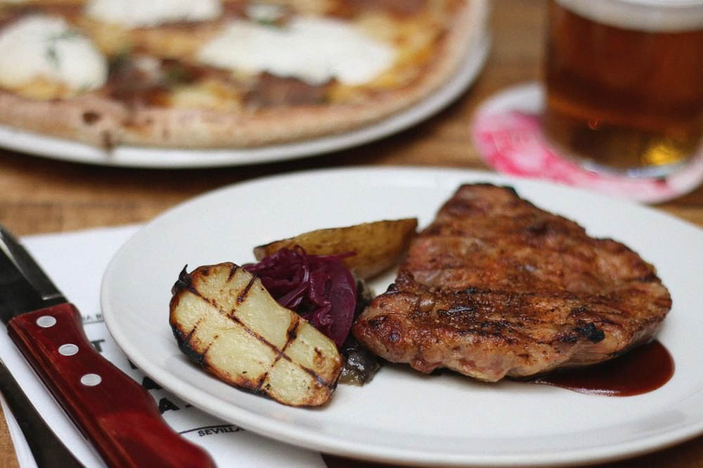 Iberian pork meat with roasted eggplant and potatoes